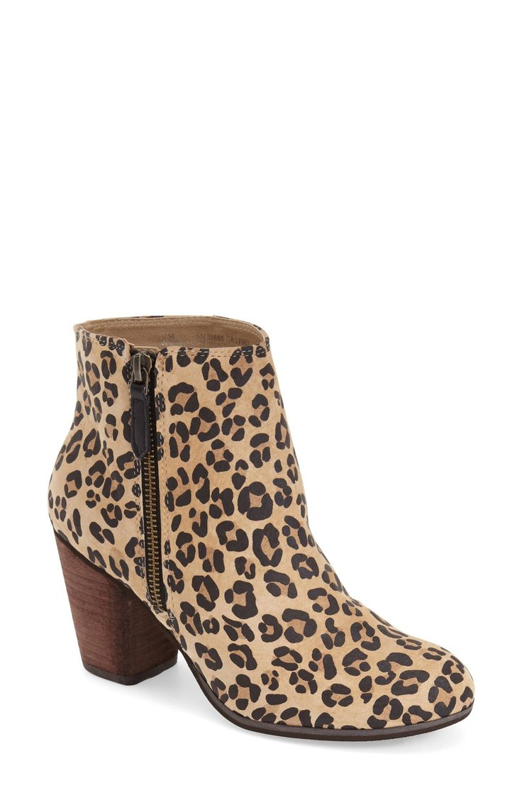 A short side zipper accentuates the abbreviated style of this go-anywhere ankle bootie in a bold leopard print.