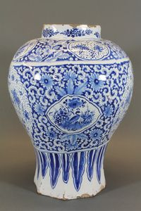 "A 17th/18th Century Dutch Delft blue and white vase decorated birds and flowers 19""h SOLD FOR £1100"