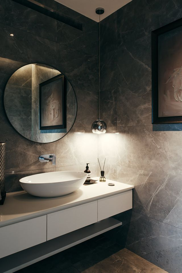 Bathroom cladded with marble tiles