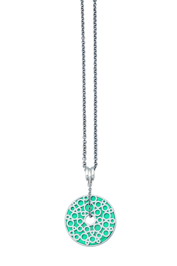Charlotte necklace with a disc in lace design and a turquoise enamel disc.