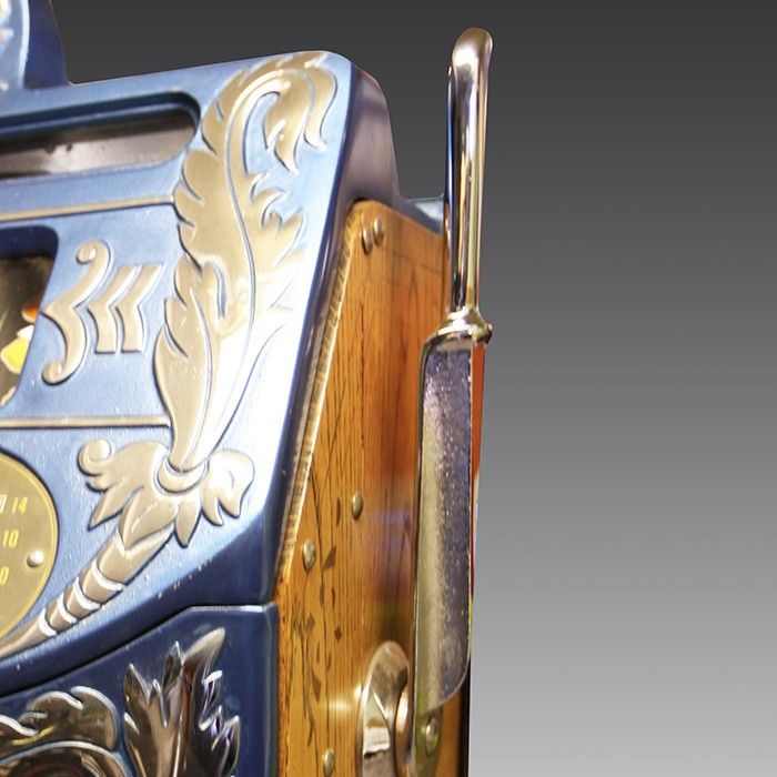 The Mills Extra Bell 'Aitkens Front' is considered by many to be one of the loveliest looking slot machines ever created. A perfect unique addition to your home or games room!