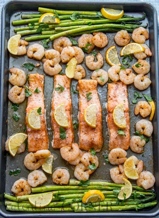 Baked one pan meal with salmon, shrimp and asparagus.