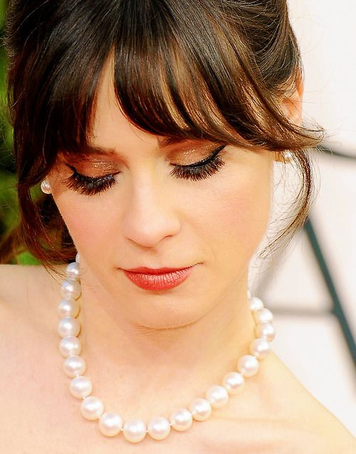Zooey Deschanel- love everything from the make up to the pearls