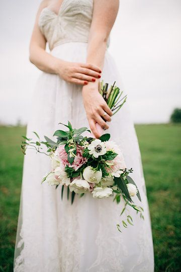 the bride's loosely tied clutch bouquet of pink and white peony, white anemone, cafe au lait dahlia, white ranunculus, white lisianthus, seeded eucalyptus, and jasmine vine was tied with pink muslin ribbon.