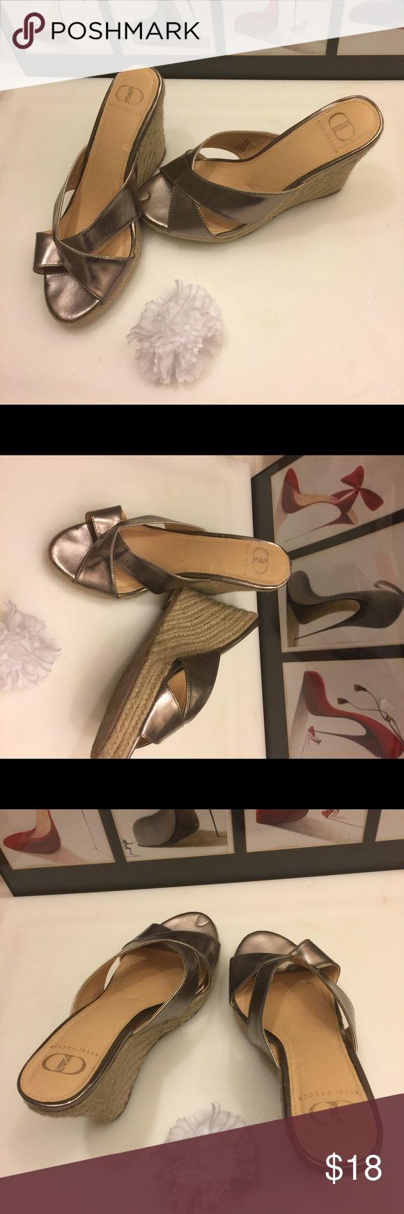 """Beautiful Wedge Metallic Espadrilles Beautiful Wedge Metallic Espadrilles in excellent preowned condition. There is a thin mark on left Wedge, not visible with shoe on.        Size:7   Heel:4"""" Kelsi Dagger Shoes Wedges"""