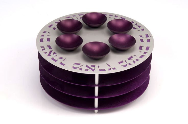 Designed by Agayof Judaica, this beautiful Seder plate is the main decoration piece on the passover table. It is a brightly colored piece comprised of six small bowls. These small bowls represent the