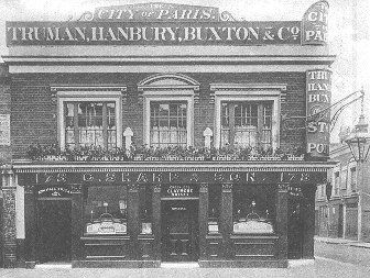 'The City of Paris' public house, 178 Old Ford Road, Bethnal Green, London E2. 'Dunville's Whisky' and the 'V crown R' on the windows over the left and corner doors, 'Greenlees Claymore Whisky' over the middle door. 'Wincarnis' on the middle door. 'Truman, Hanbury, Buxton & Co.' above the first floor. '178 C. Sharp & Son. 178' above the ground floor.