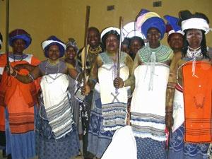 Xhosa women wearing traditional clothing incorporating Shweshwe and blankets