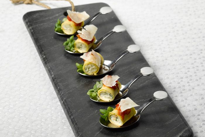 "<p> Mini cannelloni bites with ricotta, shaved mozzarella, and arrabbiata salsa, by <a href=""http://www.bizbash.com/eatertainment-special-events-catering/toronto/listing/787243"">Eatertainment</a> in Toronto</p>"
