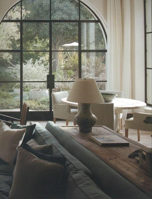 Soft, elegant interior. Neutral color palette + metal window frames.