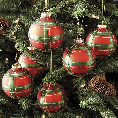 Part of our classic English Christmas collection, these fun Plaid Ornaments are hand painted in festive red and green with gold accents for extra holiday sparkle. Mix them with our glass Pinecone and Squirrel Ornaments to create the look of an English woodland holiday.: