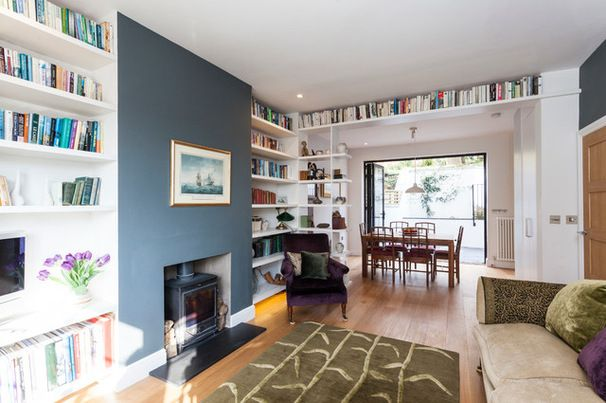 Blue wall and stove idea plus the shelving to the left with tv built in