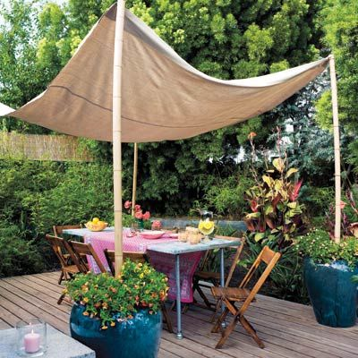 "Easy Canopy:  Erect a ""roof"" by draping a canvas drop cloth between four bamboo poles anchored in heavy planters.    Similar to shown: Super Heavy Canvas Drop Cloth, 9 by 12 feet, about $25; My Tarp.  Natural Moso Poles, about $90 for four 3-inch-by-8-foot poles; Cali Bamboo"