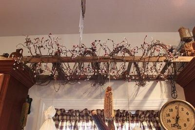 Nice idea to place ladder on kitchen cabinets if your unable to hang it on the ceiling.