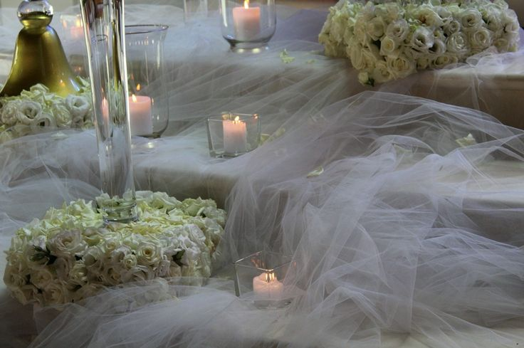 Using lots of candle light in this cute elegant wedding detailò.  Wedding: Sout-east Italy Flowers: Corflor  Wedding Florists