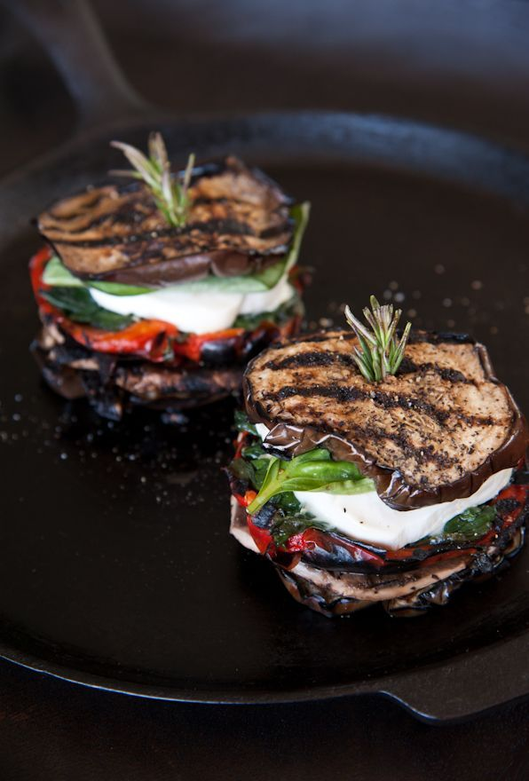 Grilled eggplant and mozzarella stacks - with roasted red peppers, portobello mushrooms, spinach, basil, and topped with pesto olive oil.