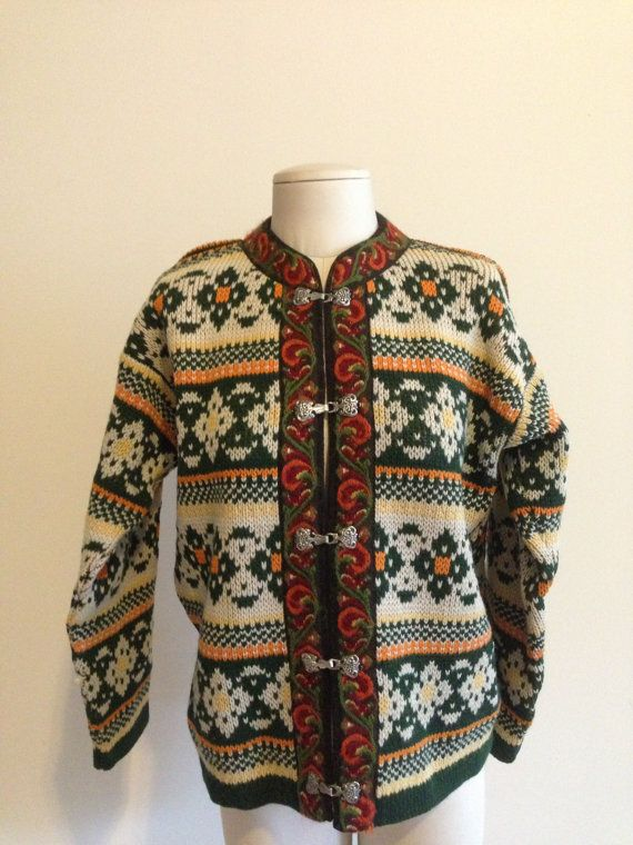 This is a vintage 1980's Nesjar of Norway green cardigan sweater.