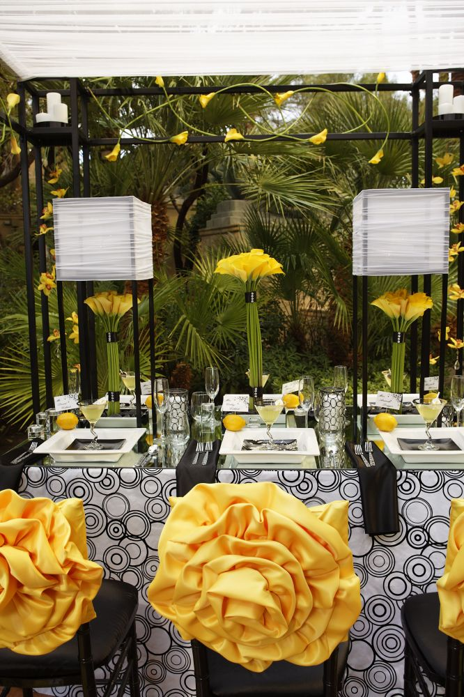 This stunning black and white tabletop contrasted with yellow cymbidium, orchids and calla lilies. Like the tall, square things. db