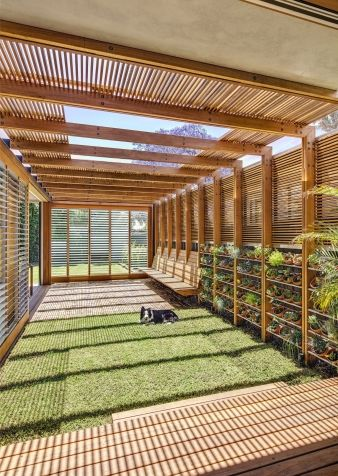 The courtyard is given a sense of partial enclosure by a timber battened pergola and privacy screen with built in timber seats, significantly increasing the family's use of their versatile, previously unused, outdoor spaces