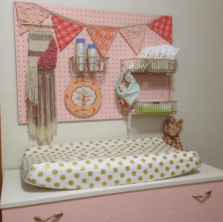 Use pegboard to organize the essentials for your diaper changing station.