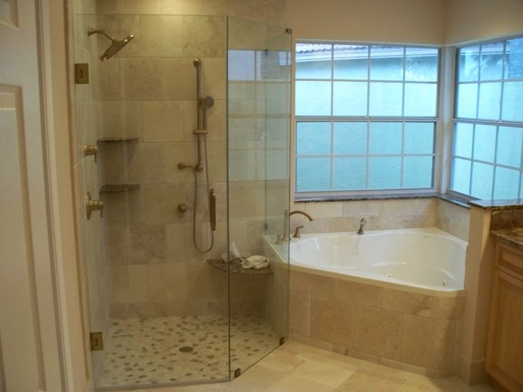 batroom design with corner bathtub and glass shower enclosure with shower with beige flooring and wooden storage