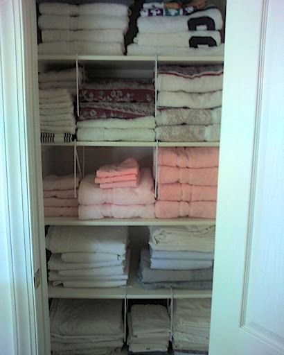 Bathroom Towel Organizing  Use the shelf dividers upside down, which keeps the top half of the towel pile from leaning or falling.   ► I purchased the same shelf dividers from Menard's ~ 2 per pack $1.99 each plus tax...