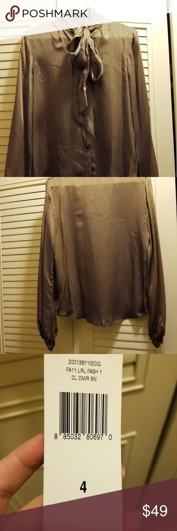 ️RALPH LAUREN silk blouse ️NWT size 4 RALPH LAUREN new with tags brown and tan houndstooth silk blouse size 4. Classic, elegant and feminine style. Original price $159 listed (seen on tag) $55 great price for timeless piece! Ralph Lauren Tops Blouses