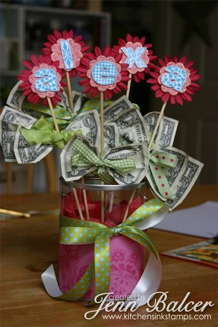 Cute grad/teen/anything gift! Maybe arrange the flower money sticks in something cute like a travel cup or mug. Too cute!