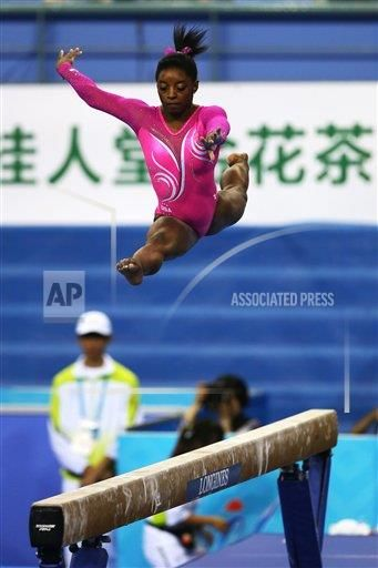 October 5, 2014 Nanning, China, Simone Biles of the US during the first day of competition and qualifying round of the FIG Artistic Gymnastics World Championships in Nanning, China. Biles won the gold medal in the all-around at the 2013 World Gymnastics Championships in Antwerp, and trains at World Champions Centre in Spring, TX. (Photo/Melissa J. Perenson/CSM (Cal Sport Media via AP Images)