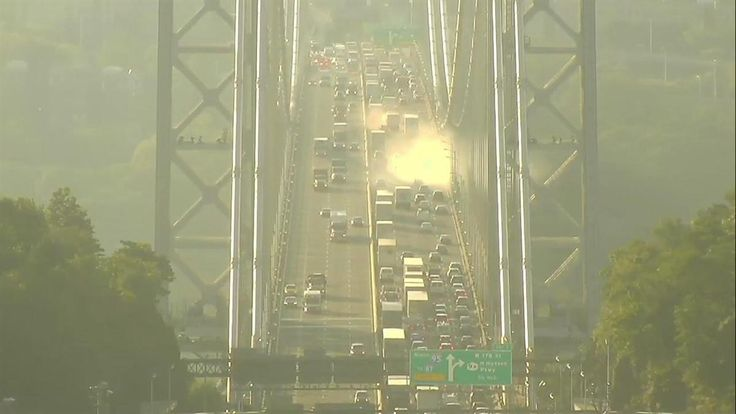 A bright white glow -- a cloud? a glare? a spirit? -- emerged suddenly on the George Washington Bridge Tuesday morning and passed slowly over the span, traffic cameras show. The explanation is probably quite simple, but it's still cool to watch. For what it's worth, it all started with a fuel spill-- but that was on the other side of the bridge. See more weird news photos.
