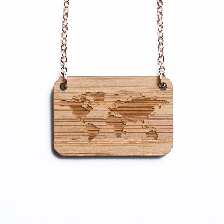 World Map necklace, etched into eco-friendly FSC certified bamboo (using a laser burner), on a recycled rose gold plated sterling silver chain.