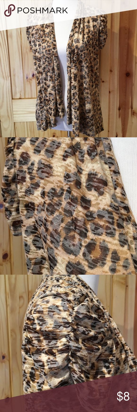 """Lightweight Animal Print Cardigan sz S AGB lightweight cardigan draped front, it's longer on the sides. The short sleeves are gathered up the center. The fabric is slightly sheer see pic. The front from the shoulder to the shortest part is 23"""". The shoulder to the longest side measurement is 27 1/2"""". Center back from neck is 23 1/2"""". Pre-loved condition still has a lot of wear left!! It is 60% cotton and 40% polyester. AGB Sweaters Cardigans"""