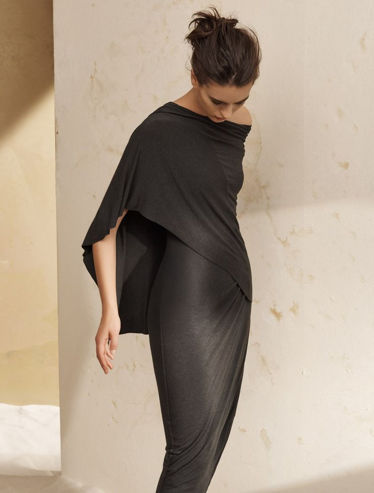 - Description - Details - Customer Care This Grecian-inspired cape dress is incredibly regal and relaxed. Its signature Donna Karan drapery and asymmetry slims the figure while capturing a tempestuous
