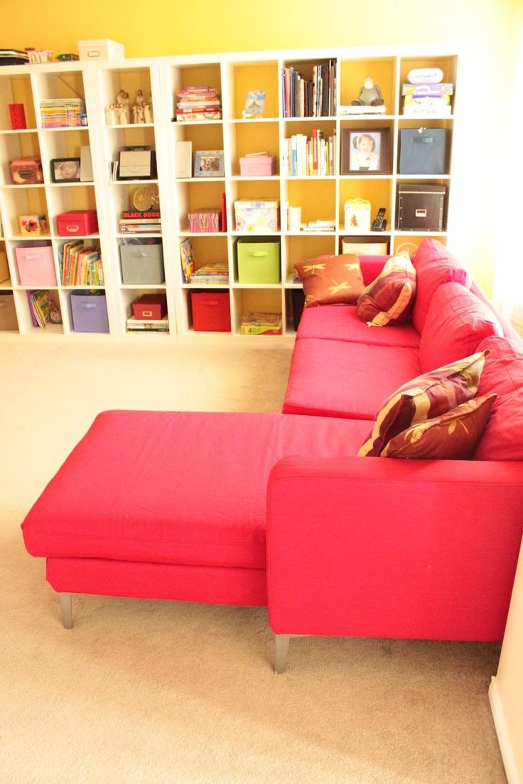 Red Sofa. Yellow Playroom. Lots of storage!
