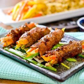 Thin-sliced lean steak wrapped around crisp veggies and pan-seared ...