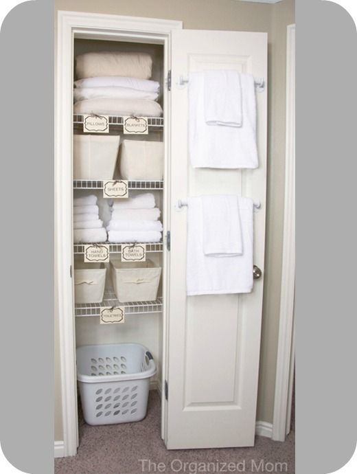 This is what my hall closet is going to look like :)  LOVE IT!  So clean and simple.  Love the towel bars ~ great use of space.