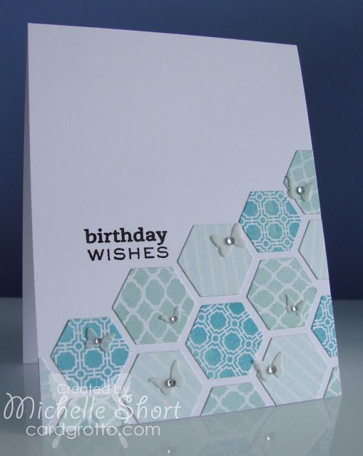 handmade birthday card ...  die cut hexagons  fill a corner ... luv the sweet little butterflies with jewels randomly placed on the hexagons ... pretty blue patterned papers ...