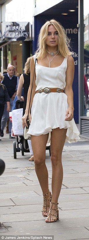 Marilyn moment: The former reality star, 26, saw a sudden gust of wind blow up her flirty white minidress as she got the week off to a good start with some retail therapy on the King's Road