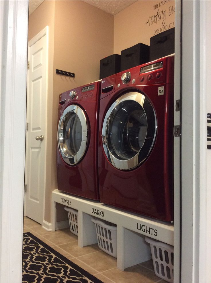 Pedestal made out of wood with laundry space underneath. Perfect and efficient for small laundry area! Love it!!