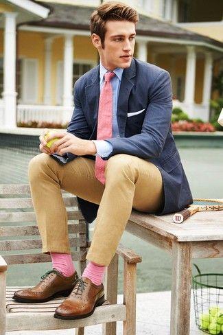 Men's Light Blue Long Sleeve Shirt, Pink Polka Dot Tie, White Pocket Square, Navy Cotton Blazer, Khaki Chinos, Pink Socks, and Brown Leather Brogues