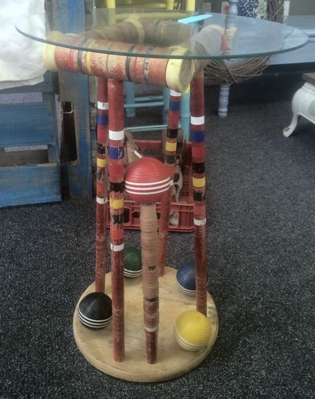 Check it out! Repurposed table, vintage croquet set. Come see us at www.frontporchfixups.com