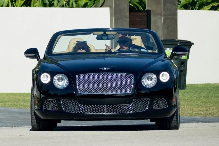 Shamed tycoon Philip Green pulls up outside Topshop store in 165000 Bentley