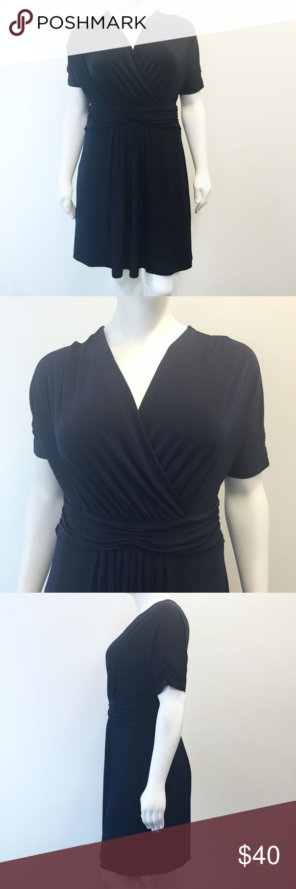 """Eloquii Navy Blue Occasion Dress Beautiful navy blue occasion dress from Eloquii! Surplice neckline with an empire waist. Dolman sleeves. Front and back pleats. In perfect condition. Smoke and pet free home. Measurements taken laid flat. 23"""" armpit to armpit. 19"""" natural waist. 25"""" waist. 30"""" hips. 41"""" long shoulder to hem. Eloquii Dresses Midi"""