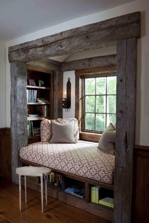 Rustic framing helps define this cozy nook as its own entity outside of the adjoining room.