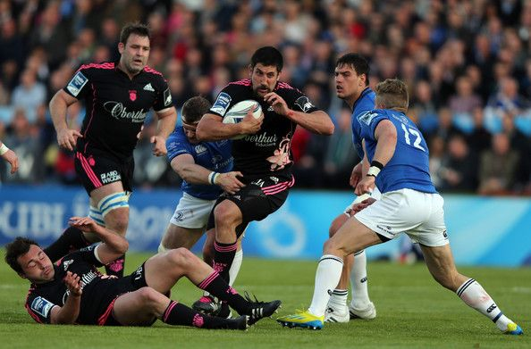Paul Williams of Stade Francais Paris is tackled by Fergus McFadden of Leinster during the Amlin Challenge Cup Final match between Leinster and Stade Francais Paris at Royal Dublin Society on May 17, 2013 in Dublin, Ireland.
