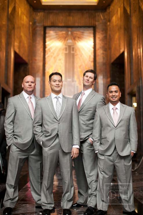 The groom and his groomsmen wait in the gorgeous art nouveau lobby at the Empire State Building.
