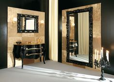 Oversized Black Wall Mirror | Modern bathroom with vintage furniture and large black wall mirror. Black and gold color scheme never failed. ➤ Discover the season's newest designs and inspirations. Visit us at http://www.wallmirrors.eu #wallmirrors #wallmirrorideas #uniquemirrors @WallMirrorsBlog