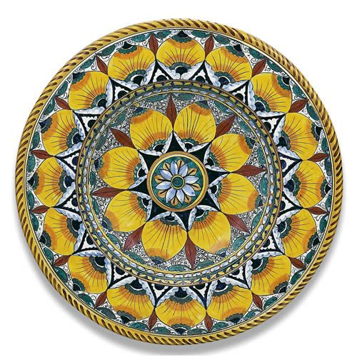 Ornato Round Platter - Pavone pattern. This vibrant platter immediately attracts the eye with its bold and unique pattern. Hand-made and hand-painted, it is truly a work of art and would be a beautiful addition to any home. Found at the Italian Pottery Outlet in Santa Barbara, CA.