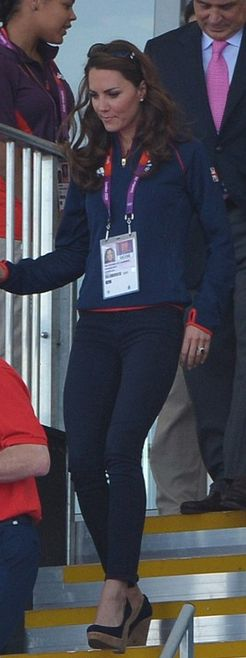 Jeans – J Brand  Sunglasses – Givenchy  Jacket – Team GB  Shirt – Adidas  Shoes – Stuart Weitzman