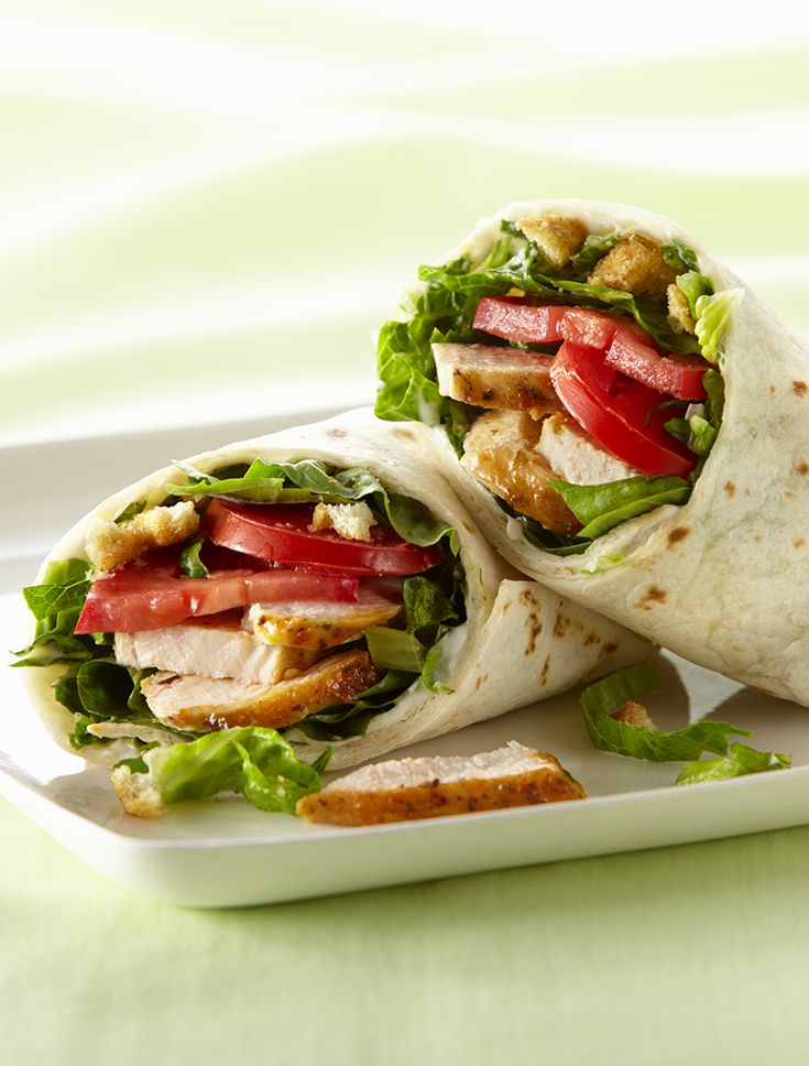 Looking for a a satisfying lunch wrap to pack for work? These Italian Chicken Wraps are made with crisp romaine, boneless chicken breasts, Parmesan Cheese and fresh basil.